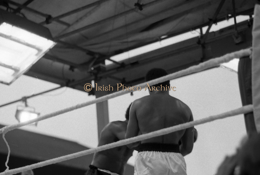 Ali vs Lewis Fight, Croke Park,Dublin.<br /> 1972.<br /> 19.07.1972.<br /> 07.19.1972.<br /> 19th July 1972.<br /> As part of his built up for a World Championship attempt against the current champion, 'Smokin' Joe Frazier,Muhammad Ali fought Al 'Blue' Lewis at Croke Park,Dublin,Ireland. Muhammad Ali won the fight with a TKO when the fight was stopped in the eleventh round.<br /> <br /> The fighters take a small breather during the fight.