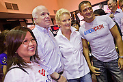 Aug. 23, PHOENIX, AZ: US Sen. JOHN McCAIN and his wife, CINDY McCAIN, pose for photos with supporters at a campaign rally in his offices in Phoenix, AZ, Monday. US Sen. John McCain held the final of his primary election campaign at his campaign offices in Phoenix Monday. McCain, Arizona's senior Republican US Senator, is facing former Congressman JD Hayworth in the primary, Tuesday, Aug. 24. McCain has outspent Hayworth by a considerable margin and is expected to win.   Photo by Jack Kurtz