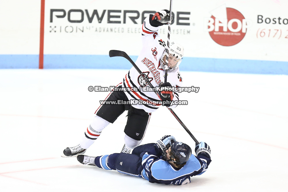 Colton Saucerman #23 of the Northeastern Huskies collides with Connor Leen #29 of the Maine Black Bears during the game at Matthews Arena on February 22, 2014 in Boston, Massachusetts . (Photo by Elan Kawesch)