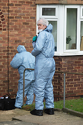 © Licensed to London News Pictures. 12/12/2018. Eltham, UK. Police and Forensic officers at a property near to the scene. A murder investigation has been launched by police after another teenager is stabbed to death in South East London over night.Photo credit: Grant Falvey/LNP