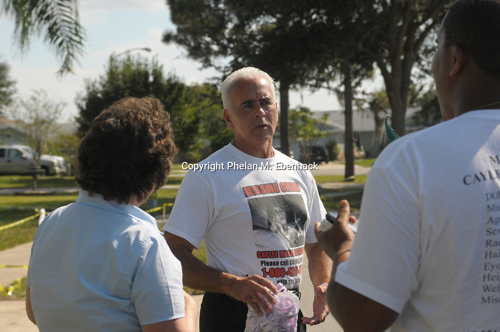 George Anthony, center, grandfather of missing three-year-old Caylee Anthony, talks to supporters after Caylee's mother, Casey Anthony, returned from her attorney's office, Friday, September 26, 2008.