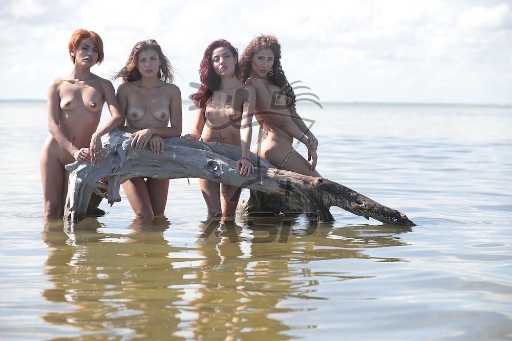 Beautiful hispanic models enjoying a day at the beach