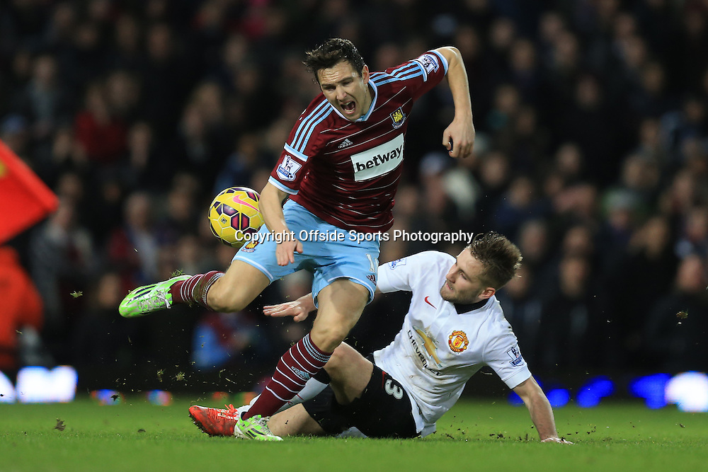 8 February 2015 - Barclays Premier League - West Ham United v Manchester United - Luke Shaw of Manchester United is shown a 2n yellow card and sent off for this late tackle on Stewart Downing of West Ham - Photo: Marc Atkins / Offside.