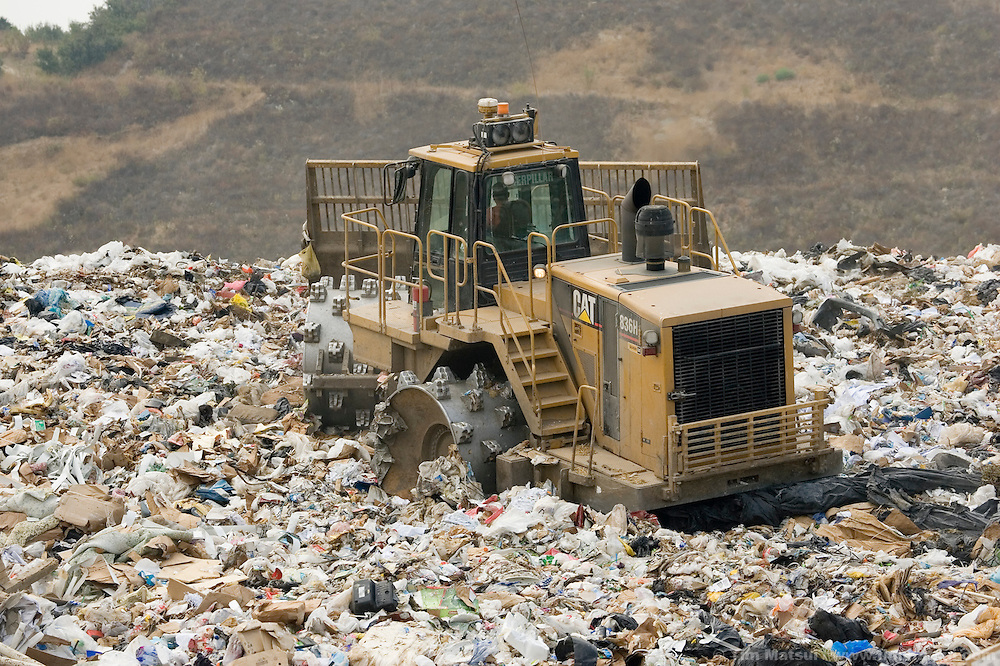 WEDNESDAY JULY 26, 2006 - LOS ANGELES, CALIF.  Heavy machinery is used to move trash in the active fill area of the Frank R. Bowerman Landfill near Los Angeles in Orange County, Calif. The landfill naturally produces methane gas from trash decomposition and Seattle-based Prometheus is installing a 5000 gallon per-day methane gas liquifying facility. Prometheus will liquify and sell the methane gas for transportation, heating, and industry. The gas is naturally produced by the landfill.