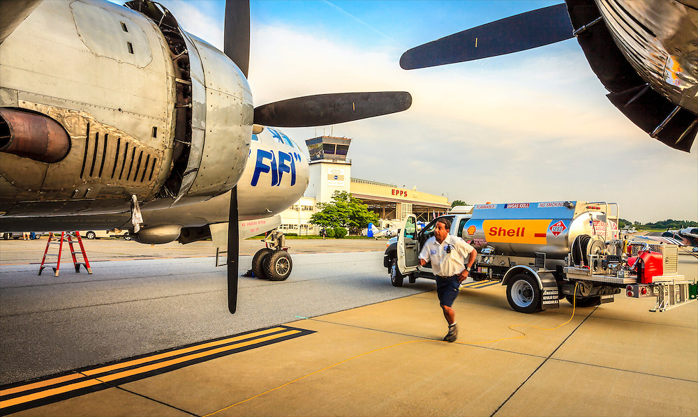 "An Epps Aviation lineman prepares to fuel ""Fifi"", the Commemorative Air Force's B-29, during a visit to Atlanta's DeKalb Peachtree Airport (PDK)."