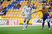 Luton Town midfielder Andrew Shinnie (11) and Mansfield Town midfielder Paul Anderson (10) during the EFL Sky Bet League 2 match between Mansfield Town and Luton Town at the One Call Stadium, Mansfield, England on 26 August 2017. Photo by Nigel Cole.