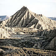 Believe or not, this is actually in Spain. At 42.000 hectares, the Bardenas Reales Natural Park is.Europe's largest desert (and one of only a handful). Just over two hours' drive from Bilbao, wind and water have sculpted a bizarre, beautiful and unique landscape. Today the reserve boasts a bulging visitors' book, from cyclists and hikers to shepherds and winemakers, all unable to resist its otherwordly.appeal