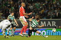 20120409: LISBON, PORTUGAL -Portuguese Liga Zon Sagres 2011/2012 - Sporting CP vs SL Benfica.<br /> In picture: Sporting's Ricky van Wolfswinkel, from Netherlands, right, shoots the ball with Benfica's Luisao, from Brazil.<br /> PHOTO: Alvaro Isidoro/CITYFILES