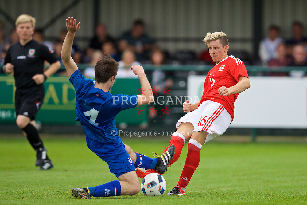 NEWPORT, WALES - Tuesday, September 6, 2016: Wales' Aaron Lewis in action against Iceland's Viktor H Benediktsson during the International Friendly match at Dragon Park. (Pic by David Rawcliffe/Propaganda)