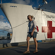 WEDNESDAY, OCTOBER 4- 2017--- - SAN JUAN, PUERTO RICO - <br /> Aida Pagan, 59 from San Juan, walks away from the US Naval Hospital Ship Comfort at the Port of San Juan where it started treating patients affected by Hurricane Maria.<br /> (Photo by Angel Valentin for NPR)