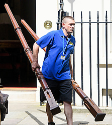 © Licensed to London News Pictures. 16/07/2016. London, UK. What look like bed posts being placed in a van for David Cameron. Removal men begin to take items from numbers 10 and 11 at Downing Street at the end of the week that saw Prime Minister David Cameron leave and Theresa May arrive. Photo credit: Ben Cawthra/LNP