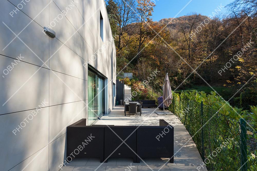 external of a modern house, patio with garden furniture