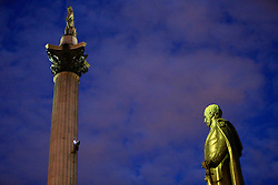 UK ENGLAND LONDON 18APR16 - Two Greenpeace activists climb Nelson&rsquo;s Column at 4am to demand action on air pollution. Alison Garrigan (29) and Luke Jones (30) fit the statue of Admiral Lord Nelson, towering 52 metres above Trafalgar Square, with an emergency face mask. <br /> <br /> <br /> <br /> jre/Photo by Jiri Rezac<br /> <br /> / Greenpeace<br /> <br /> &copy; Jiri Rezac 2016