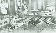 A hamam or Turkish bath with a masseur. North African circa 1900