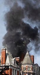 © Licensed to London News Pictures. 06/06/2018. London, UK. Smoke pours from the roof of the Mandarin Oriental Hotel in Knightsbridge where a fire has broken out. Photo credit: Rob Pinney/LNP