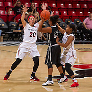 04 November 2016: The San Diego State Aztecs women's basketball team opens up the season with an exhibition against CSU San Marcos.  San Diego State guards Geena Gomez (20) and Ariell Bostick (3) apply full court pressure to San Marcos guard Ashley Jenkins in the second quarter. The Aztecs beat the Cougars 74-53 at Viejas Arena Friday night. . www.sdsuaztecphotos.com
