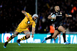 Tom O'Flaherty of Exeter Chiefs breaks free as Nizaam Carr of Wasps challenges him - Mandatory by-line: Ryan Hiscott/JMP - 30/11/2019 - RUGBY - Sandy Park - Exeter, England - Exeter Chiefs v Wasps - Gallagher Premiership Rugby