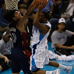Mar 24, 2010; New Orleans, LA, USA; New Orleans Hornets guard Marcus Thornton (5) shoots over Cleveland Cavaliers forward Anderson Varejao (17)during the first half at the New Orleans Arena. Mandatory Credit: Derick E. Hingle-US PRESSWIRE