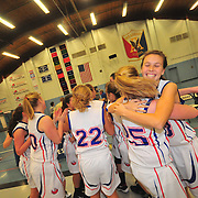 12/17/10 -- TOPSHAM, Maine. Mt Ararat girls celebrate after closing a 10 point gap to beat Cony at home on Friday night. Cony led 15-5 at the end of the first quarter - but Mt Ararat capitalized on Cony's many errors - and played scrappy defense through the entire game, tying at 34 late in the 4th quarter, and pressing on to win 45-42. After losing to both Morse and Brunswick in recent games, this was a sweet victory for the Eagles. Photo by Roger S. Duncan.