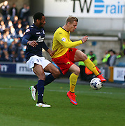 Matej Vydra piece of skill to beat Shaun Cummings during the Sky Bet Championship match between Millwall and Watford at The Den, London, England on 11 April 2015. Photo by Matthew Redman.