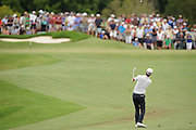 GOLD COAST, AUSTRALIA - DECEMBER 14:  Jason Scrivener of Australia hits his approach shot on the 8th hole during day four of the 2014 Australian PGA Championship at Royal Pines Resort on December 14, 2014 on the Gold Coast, Australia.  (Photo by Matt Roberts/Getty Images)