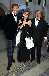 Left to right, TIM HADCOCK-MACKAY, MARIE-CLAIRE BARONESS VON ALVENSLEBEN and PETER HARRISON at a tribute to Luciano Pavarotti in aid of the British Red Cross held at The Guildhall, City of London on 6th June 2005<br />