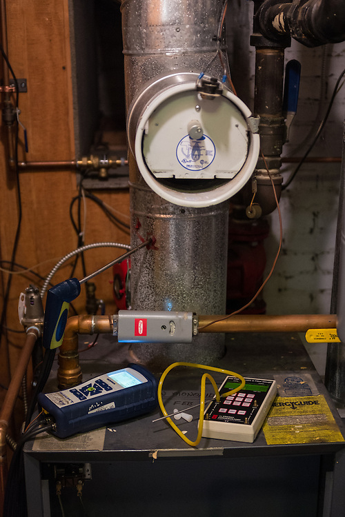 The furnance at 86 West State Street awaits testing during an energy audit on Wednesday, June 24, 2015.  Photo by Ohio University  /  Rob Hardin