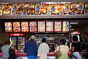 Hungry Lion fastfood shop in downtown Windhoek, Namibia, does a brisk business selling burgers, fries, and chicken. (From the book What I Eat: Around the World in 80 Diets.)