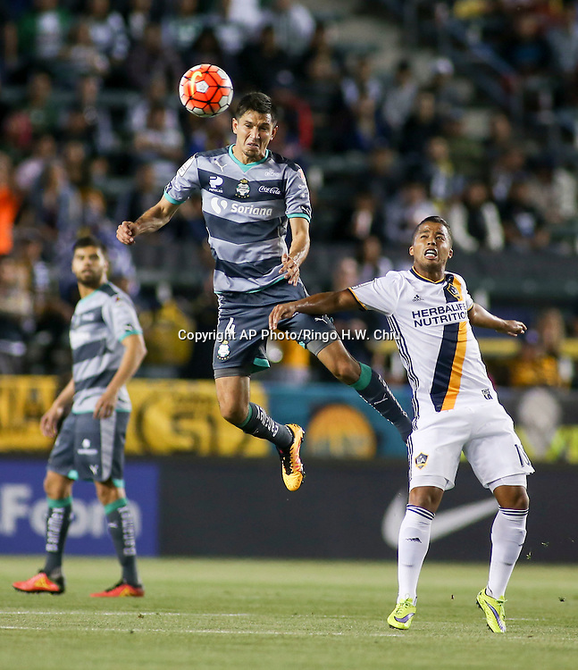 Santos Laguna midfielder Jesus Molina, center, in actions during the first half of a CONCACAF Champions League quarterfinal against Los Angeles Galaxy in Carson, Calif., Wednesday, Feb. 24, 2016. (AP Photo/Ringo H.W. Chiu)