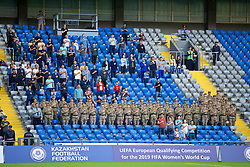 ASTANA, KAZAKHSTAN - Sunday, September 17, 2017: Kazakhstan army and supporters stand for the national anthem before the FIFA Women's World Cup 2019 Qualifying Round Group 1 match between Kazakhstan and Wales at the Astana Arena. (Pic by David Rawcliffe/Propaganda)