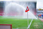A general view of the corner flag as the sprinklers spray the pitch before the EFL Sky Bet Championship match between Barnsley and Swansea City at Oakwell, Barnsley, England on 19 October 2019.