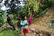 Aastha Baniya (6, in blue) plays with her cousins in front of their temporary home in Chautara, Sindhupalchowk, Nepal on 29 June 2015. The three girls lost their mother during the April 25th earthquake that completely levelled their house. Aastha was buried under the rubble together with her mother but Aastha survived. As their father Ratna Baniya (28) cannot care for the children on his own, SOS Childrens Villages has since been supporting the grandmother with financial and social support so that she can manage to raise the children comfortably and ensure that they will all be schooled. Photo by Suzanne Lee for SOS Children's Villages