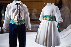 Windsor, UK. 28th February, 2019. A bridesmaid and pageboy outfit by London-based children's designer Amaia Kids which will go on display with other items from the wedding outfits of HRH Princess Eugenie and Mr Jack Brooksbank at Windsor Castle in a special exhibition named 'A Royal Wedding: HRH Princess Eugenie and Mr Jack Brooksbank' from 1st March to 22nd April. The highlights of the exhibition include Princess Eugenie's wedding dress created by Peter Pilotto and Christopher De Vos of the British-based label Peter Pilotto, the Greville Emerald Kokoshnik Tiara, on public display for the first time, two diamond wheat-ear brooches lent by Her Majesty the Queen, diamond and emerald drop earrings gifted to the bride by the groom, Mr Jack Brooksbank's morning suit made by tailors at Huntsman on Savile Row, Princess Eugenie's evening gown by American designer Zac Posen and HRH Princess Beatrice's blue dress by the London-based couture house Ralph & Russo.
