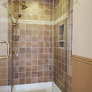 CREAM RIDGE, NJ - OCTOBER 29, 2016: The first floor full bathroom has a tiled shower stall, wainscoting and tile floor. 92 Holmes Mill Rd, Cream Ridge, NJ. Credit: Albert Yee for the New York Times