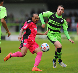 Dover Athletic's Ricky Modeste and Forest Green Rovers's Sam Wedgbury battle for the ball.  - Photo mandatory by-line: Nizaam Jones - Mobile: 07966 386802 - 25/04/2015 - SPORT - Football - Nailsworth - The New Lawn - Forest Green Rovers v Dover - Vanarama Conference League