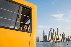 Construction worker on bus to living quarters at end of working day in Dubai United Arab Emirates