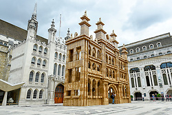 © Licensed to London News Pictures. 21/07/2019. LONDON, UK.  The People's Tower, a monumental cardboard structure, built by artist Olivier Grossetête aided by a local volunteers, stands in Guildhall Yard.  Over 1,000 boxes have been used to build the 20m high artwork, inspired by the Guildhall building.  The four day construction process culminates in the structure being ceremonially torn down.  Photo credit: Stephen Chung/LNP