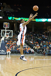 UVA's Monica Wright (22) shoots an open three pointer.  Wright later connected on a game winning three point basket as the Cavaliers defeated the Eagles 65-63 in overtime at the John Paul Jones Arena in Charlottesville, VA on January 14, 2007.