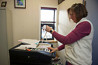 Laconia City Clerk Cheryl Hebert tests voting machines for the upcoming NH Presidential Primary.  Karen Bobotas for the Laconia Daily Sun