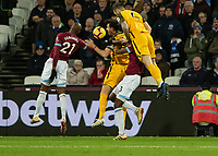 Football - 2018 / 2019 Premier League - West Ham United vs. Brighton & Hove Albion<br /> <br /> Shane Duffy (Brighton & Hove Albion) rises highest as he uses Aaron Cresswell (West Ham United) to get height at the London Stadium<br /> <br /> COLORSPORT/DANIEL BEARHAM