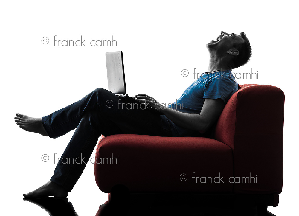one caucasian man Laughing computer computing laptop in silhouette isolated on white background