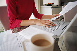 Dec. 14, 2012 - Woman working at kitchen table (Credit Image: © Image Source/ZUMAPRESS.com)