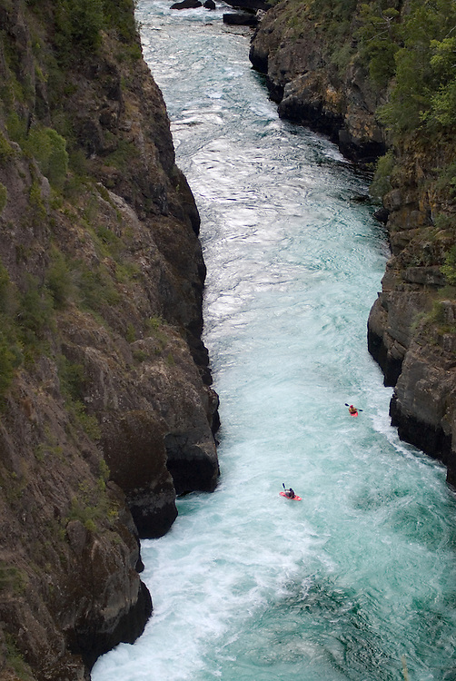 Kayakers paddling through a canyon on Chile's Futaleufu River.