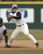 Kansas State third basemen Eli Rumler (C) gets ready to throw to first, after forcing out Missouri base runner Greg O'Neill (L) in the top of the fourth inning at Tointon Stadium in Manhattan, Kansas.  Missouri defeated Kansas State 6-5, March 26, 2005.