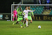 Truro's River Allen is challenged by Forest Green Rovers Drissa Traoré(4) and Forest Green Rovers Ethan Pinnock(16) during the FA Trophy match between Truro City and Forest Green Rovers at Treyew Road, Truro, United Kingdom on 13 December 2016. Photo by Shane Healey.