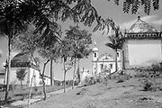 Brazil – Congonhas do Campo – Santuario do Bom Jesus de Matosinhos – view of Basilica with oratorios of Stations of the cross in the foreground