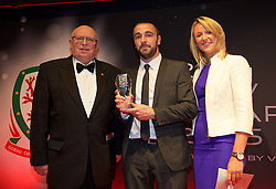 CARDIFF, WALES - Monday, October 5, 2015: Bangor City's Sion Edwards is presented with the Welsh Premier League Clubman if the Year award by WPL Chairman Peter Rees and Princes Gate's Samantha Atkinson during the FAW Awards Dinner Dinner at Cardiff City Hall. (Pic by David Rawcliffe/Propaganda)