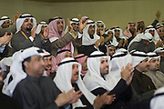 Kuwaiti men cheer on former MP  Faisal Al-Mislem as he speaks at a Jan. 18  rally in Kuwait City to mark the opening of the elections HQ of Ahmad Al-Sadoun, a veteran Kuwaiti politician and three-time former Speaker of Parliament. Al-Mislem and Al-Sadoun are among some 340 candidates who are running in the Feb. 2, 2012 polls to elect a new 50-seat National Assembly.