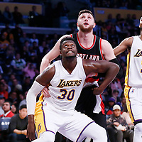 26 March 2016: Los Angeles Lakers forward Julius Randle (30) vies for the rebound with Portland Trail Blazers center Jusuf Nurkic (27) next to Los Angeles Lakers forward Corey Brewer (3) during the Portland Trail Blazers 97-81 victory over the Los Angeles Lakers, at the Staples Center, Los Angeles, California, USA.