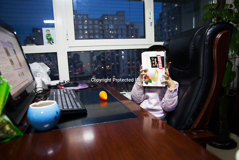 Beijing, March 11 : Tian Ye, 3, plays at his parents' desk while his older brother Tian Peng, 15, is taken care of by his mother Cui Xinying .<br /> As a baby Tian Peng fell ill with brain   hemorrhage supposedly due to a lack of vitamin K. When Tian Peng was a kid, friends advised the parents to simply abandon him as there's neither enough help nor support in China apart from a small NGO. Tian is unable to speak, think, walk and needs help for everything.<br /> Chinese attitudes towards people with disabilities have improved in recent years, but the support of society and opportunities in education and employment are scarce.